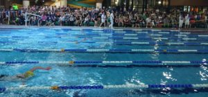 Spectators and swimmers in foreground at LSC Easter Meet